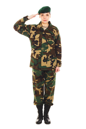 green beret: Soldier girl in the camouflage military uniform and beret greets someone