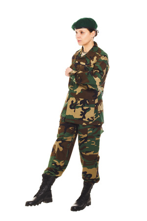 corporal: Soldier girl in the camouflage military uniform and hat marches to somewhere