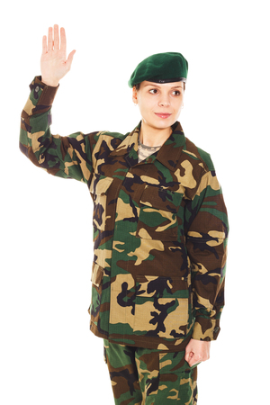 corporal: Soldier in the camouflage military uniform and beret waves by the hand