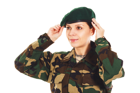 corporal: Portrait of soldier girl in the camouflage military uniform holds the beret, isolated