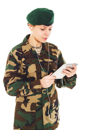 corporal: Soldier girl in the camouflage military uniform and beret holds a tablet, isolated