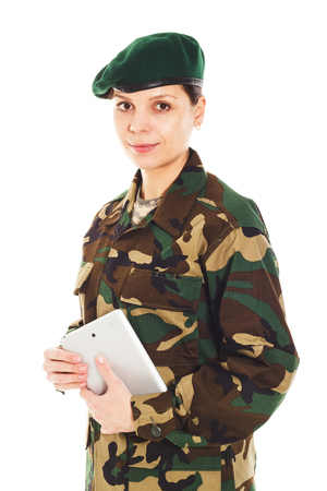 green beret: Portrait of soldier girl in the camouflage military uniform and beret holds a tablet, isolated