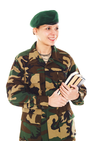 corporal: Smiling soldier girl in the camouflage military uniform and beret holds books, isolated
