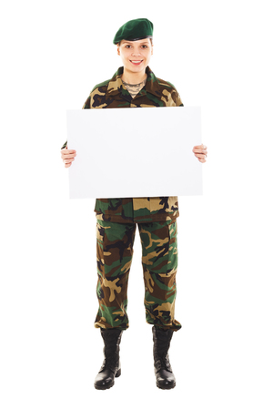 corporal: Smiling soldier girl in the camouflage military uniform and beret holds a plate, isolated