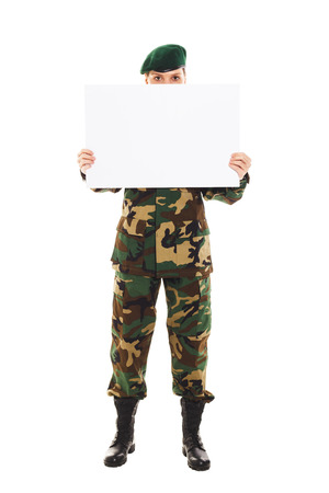 lieutenant: Soldier girl in the camouflage military uniform and beret holds a plate, isolated Stock Photo