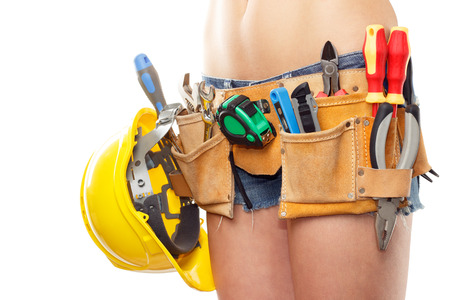 Woman builder with belt for different construction tools, isolated