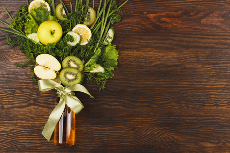 greenery: Bouquet of greenery and fruits, wooden background Stock Photo