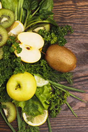 greenery: Set of greenery and fruits, wooden background