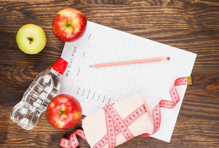 diet plan: Diet plan, red apples and bottle, wooden background Stock Photo
