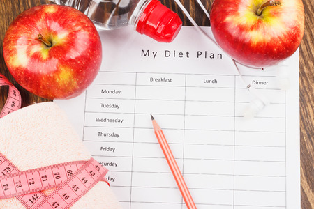 diet plan: Diet plan, red apples and towel, wooden background Stock Photo