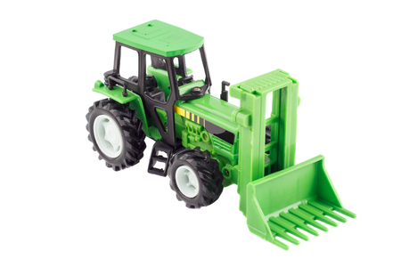 mini farm: Childrens plastic tractor toy, isolated