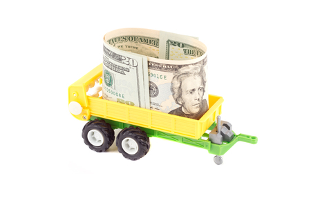 mini farm: Yellow plastic trailer toy with dollar inside, isolated