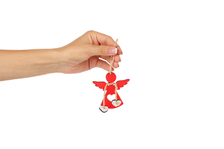 Wooden toy for Christmas tree in the womans hand, isolated