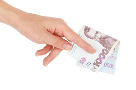 Thousand hryvnias by one banknote in the hand, isolated on the white Banco de Imagens