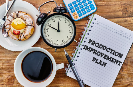 mangement: Production Improvement Plan - The modern concept of time management to reach the goal of increasing productivity. Stock Photo