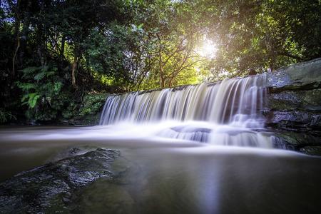 A beautiful scenery of waterfall during sunrise Stock Photo