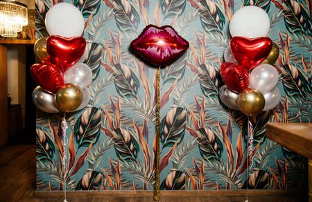 Photo zone with balloons in the form of lips. Stock Photo