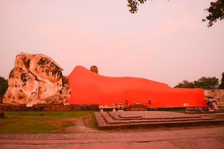 reclining: Sunset reclining Buddha Stock Photo