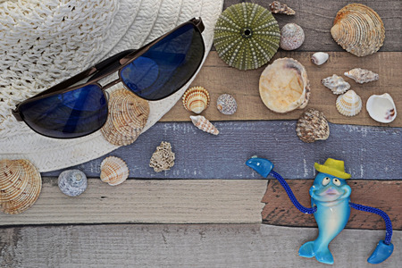 furlough: beach accessories on wooden board