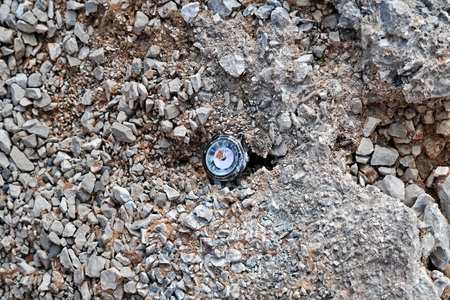 attached: Broken watch attached to the rock