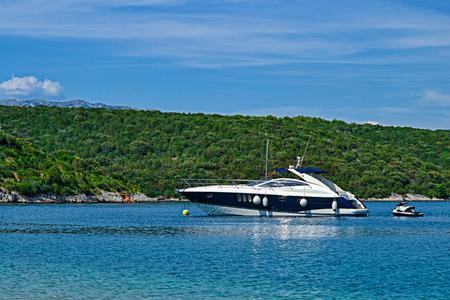 jet ski: Motorboat with jet ski on an azure sea