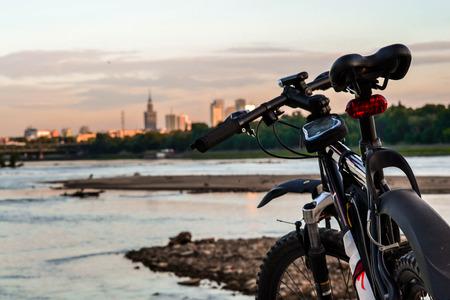 Bike on a city landscape background Stock Photo