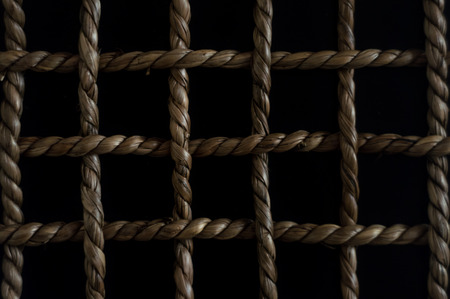 interspersed: Chequered pattern with rope Stock Photo