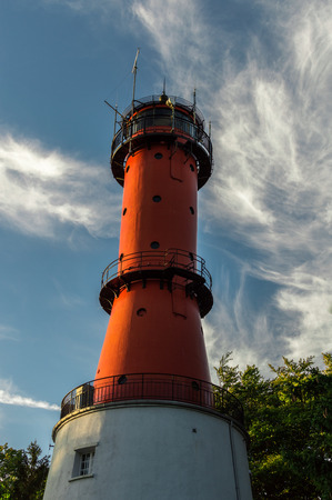 Lighthouse with sky and clouds background, located in Jastrzebia Gora at the Baltic Sea coast Poland.
