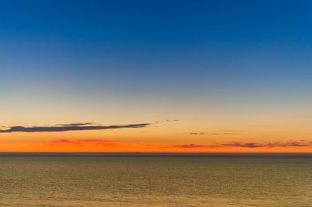 quite: Sunrise at sea shore. Colorful sky.