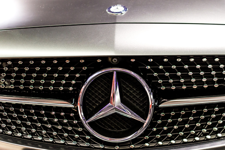 Mercedes Benz logo close up. Mercedes-Benz is a German automobile manufacturer. The brand is used for luxury automobiles, buses, coaches and trucks.