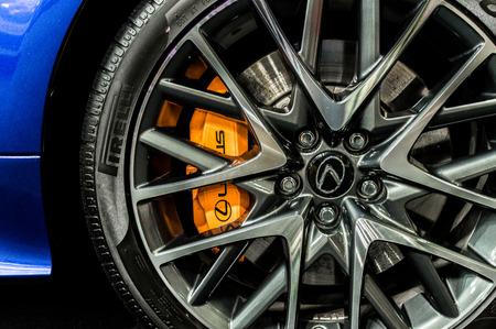 Close up of a cars rim, wheel with Lexus emblem.