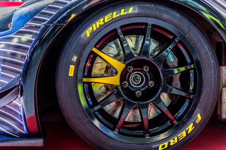Close up of a cars rim, wheel, and tire breaks with Pirelli emblem.