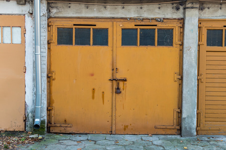 dowdy: Old metal garage door color. Stock Photo