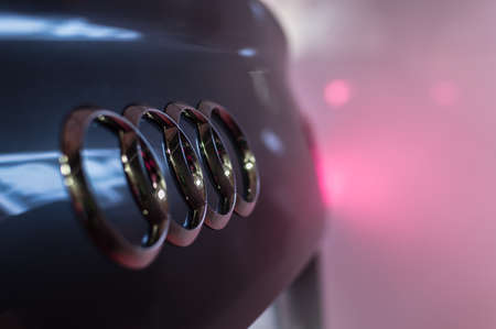 Audi emblem and taillight in fog or smoke Stock Photo