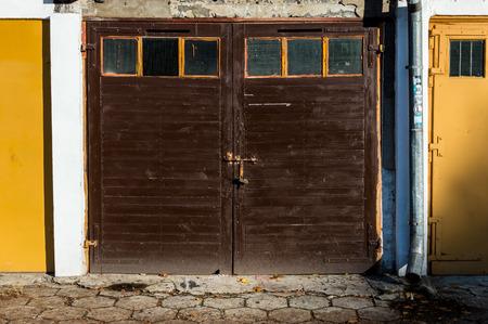 dowdy: Old wooden garage door color.