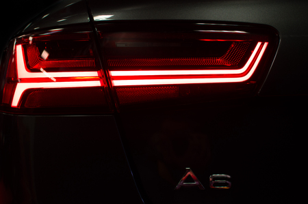 Audi A6 light close up. The brand is used for luxury automobiles, buses, coaches and trucks. Editorial