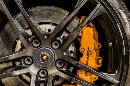 daimler: Close up of a cars rim, wheel and breaks with Lamborghini emblem.