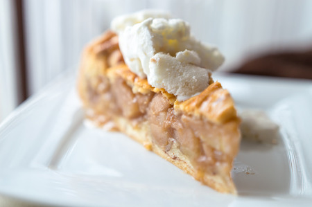 Hot apple pie with ice cream on top - concept on a white plate Stok Fotoğraf