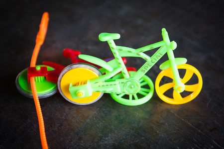 mini bike: general low-cost mini toy plastic bike on wood table with feeling of remembrance