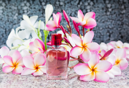 eau de perfume: Single bottle of sweet pink fragrant perfume decorated with pink flower plumeria