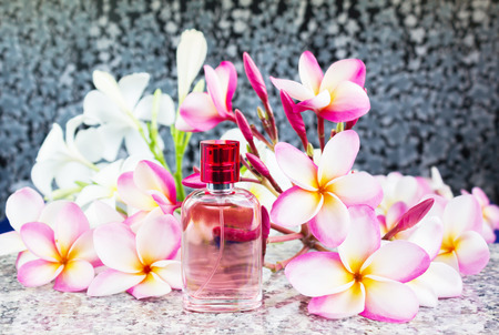 eau: Single bottle of sweet pink fragrant perfume decorated with pink flower plumeria