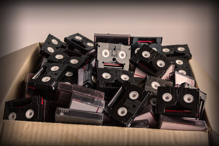video cassette tape: Vintage style of abandoned pile of old useless mini DV (video cassette tape or betamax) Stock Photo