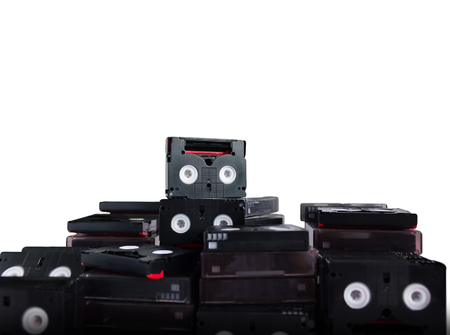 video cassette tape: (with clipping path)Abandoned pile of old useless mini DV (video cassette tape or betamax) on white background Stock Photo