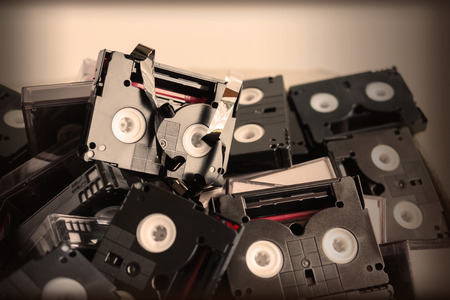 video cassette tape: Abandoned pile of old useless mini DV (video cassette tape or betamax) in old vintage colour style Stock Photo