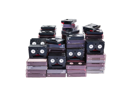 (With clipping path) Isolated abandoned pile of old useless mini DV (video cassette tape or betamax) on white background
