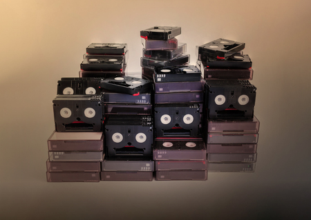 Vintage style of abandoned pile of old useless mini DV (video cassette tape)