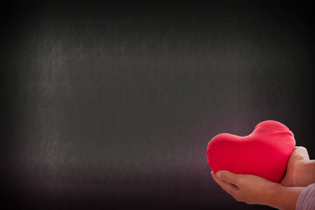 gently: Romantic lovely valentine concept with hand gently raise up red heart on soft bokeh background