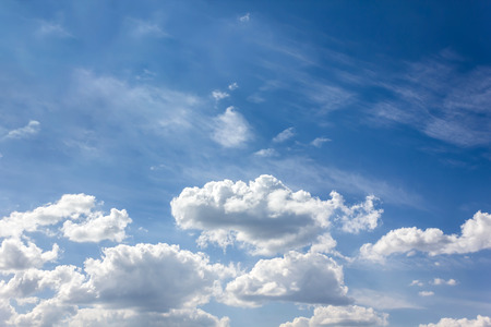 puffy: Puffy clouds on light blue sky Stock Photo