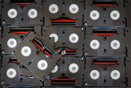 video cassette tape: Abandoned pile of old useless mini DV (video recording cassette tape)