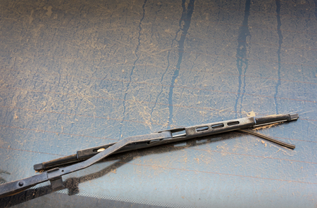 dirty car: Old windshield wiper and mirror covered by dust, dirty car
